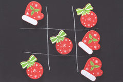 Christmas tic tac toe board game. Tic tac toe board game with Christmas ornaments Royalty Free Stock Photo