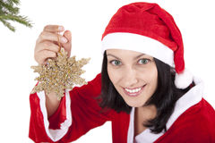 Christmas time. Smiling girl in christmas cap with toy in hand over white royalty free stock photography