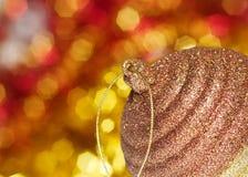 Christmas time. Golden ball and sparkling lights Stock Image