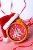 Christmas time. Alarm clock with a cap santa. Without five twelve Stock Photos