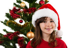 Christmas time. Girl with Santa Claus hat isolated on white background Stock Image