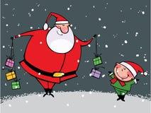 Christmas time. Funny kid and Santa with gift Stock Photo