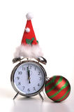 Christmas Time. Photograph of an alarm clock with a christmas hat on and christmas bauble Stock Photos