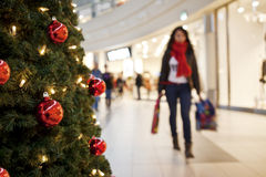 Christmas time. Christmas tree and shopping in the mall Stock Photo