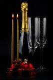 Christmas time. Christmas decorations, candles and champagne bottle Stock Photo