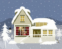 Christmas time. Christmas greeting card with heartwarming winter house in mountains Royalty Free Stock Images
