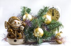 Christmas time (3 with snowman). Christmas tree with golden ornaments, clock with one minute till twelve, and a smiling snowman Royalty Free Stock Photo