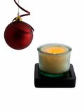 Christmas Time. Christmas ornament and lit candle isolated on white Stock Photo
