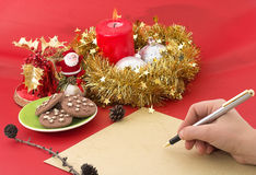 Christmas time. Hand Writing a Christmas list, closeup Stock Photos