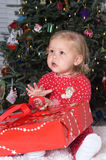 Christmas Time. Adorable Baby Girl in Pajamas with Christmas Present Royalty Free Stock Images