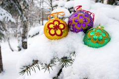 Christmas time. Three color christmas baubles sitting in a bed of snow Royalty Free Stock Image