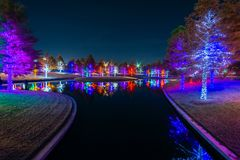 Christmas Lights Sparkle at Vitruvian Park in Addison Texas. Christmas time in Addison Texas as lights fill the trees at Vitruvian Park royalty free stock images