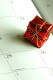 Christmas time again. Red foil Xmas gift on a calender with the date of the 25th Christmas day Royalty Free Stock Image