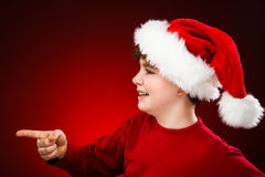 Christmas time boy pointing at something Stock Photos
