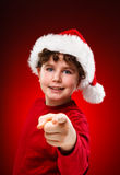 Christmas time boy pointing at you Stock Photo