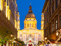 Christmas time in Budapest. Illuminated dome of Saint Stephen`s Basilica with holiday street decoration by night Stock Image