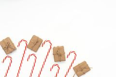Christmas time. Candy canes in a glass, wooden background, copy space royalty free stock image
