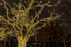 Christmas time city decoration. Lights and toys on the city street during winter holiday season. Festive illuminations in the. Streets of the city.Festive royalty free stock images
