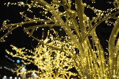 Christmas time city decoration. Lights and toys on the city street during winter holiday season. Festive illuminations in the. Streets of the city.Festive royalty free stock photography