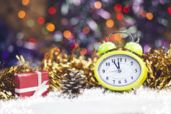 Christmas Time. Clock, Cristmast gifts and colorful lights Royalty Free Stock Photos