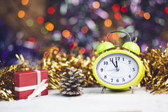 Christmas Time. Clock, Cristmast gifts and colorful lights Royalty Free Stock Image