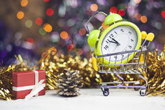 Christmas Time. Clock, Cristmast gifts and colorful lights Stock Photos