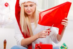 Young woman preparing gifts for Christmas Stock Image
