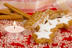 Christmas time cookies. Christmas cookies on red, decorated with glittering objects stock image