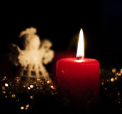 Christmas time. Decoration with candle and a sweet angel royalty free stock photography