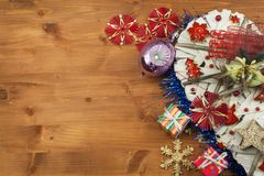 Christmas time. Decorations for the presents. Christmas ornaments on a wooden board. Home-made Christmas ornaments. Stock Photo