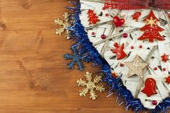 Christmas time. Decorations for the presents. Christmas ornaments on a wooden board. Home-made Christmas ornaments. Stock Images