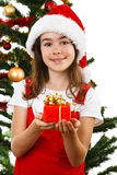Christmas time - girl with Santa Claus Hat Royalty Free Stock Photos