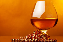 Christmas time and glass of whiskey Royalty Free Stock Image