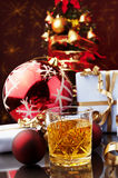 Christmas time and glass of whiskey Stock Images