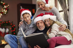 Christmas time for happy family. Do you want to hear another Christmas tale Royalty Free Stock Photography