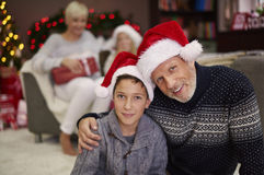 Christmas time for happy family. Portrait of father and son in santa hats Royalty Free Stock Photography