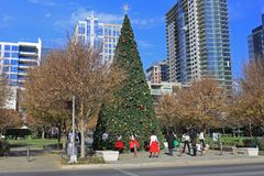 Christmas time in Klyde Warren Park in Downtown Dallas. View of Christmas tree and people in small park in Downtown Dallas December 15th, 2017 Royalty Free Stock Image