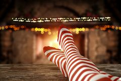 Free Christmas Time, Legs In Winter Socks, Elf Stockings. Space For Your Text Or Decoration. Old Fireplace Wall Background. Stock Images - 163961334