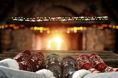 Free Christmas Time, Legs In Winter Socks. Space For Your Text Or Decoration. Old Fireplace Wall Background. Stock Photo - 163960290