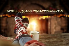 Free Christmas Time, Legs In Winter Socks. Space For Your Text Or Decoration. Old Fireplace Wall Background. Stock Photo - 163960880