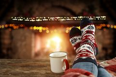 Free Christmas Time, Legs In Winter Socks. Space For Your Text Or Decoration. Old Fireplace Wall Background. Royalty Free Stock Images - 163960919