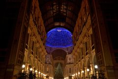 Christmas time in Milan city center. View of Vittorio Emanuele's Gallery lights in Milan during Christmas days stock photo