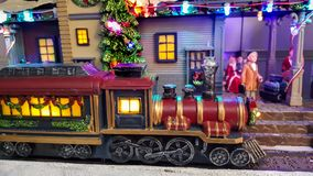 Christmas season miniature street scene with a train Royalty Free Stock Image