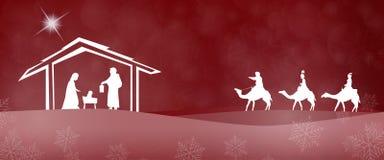 Christmas time - Nativity scene. Nativity scene with Mary, Joseph, baby Jesus and three kings in Christmas landscape Stock Photo