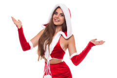 Christmas time. Pretty female wearing santa claus hat on white b stock photography