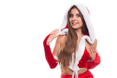 Christmas time. Pretty female wearing santa claus hat on white stock photography