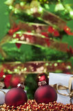 Christmas time red ball green tree Stock Photography