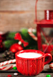 Christmas time red cup of milk and latern with candle light, hol Royalty Free Stock Photography
