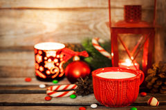 Christmas time red cup of milk and latern with candle light, hol Stock Photo