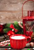 Christmas time red cup of milk and latern with candle light, hol Stock Photography